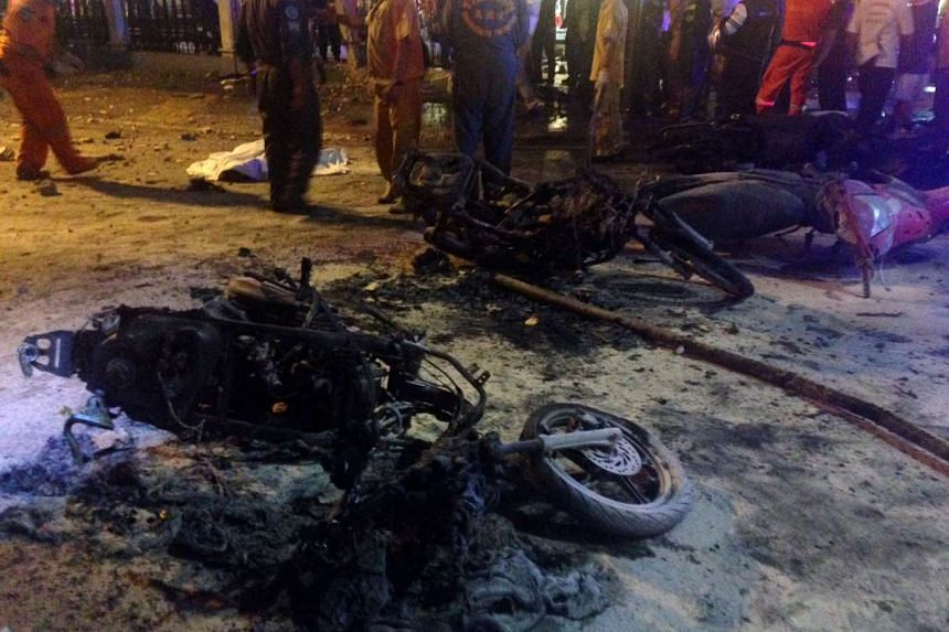Destroyed motorbikes are pictured at the scene of devastation after a bomb exploded outside a religious shrine in central Bangkok late on August 17, 2015 killing at least two people and wounding scores more.