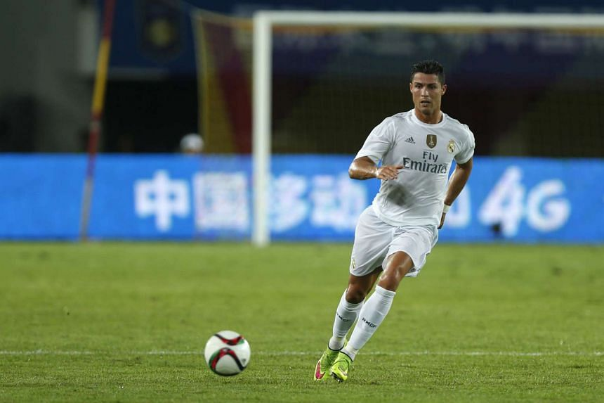 Real Madrid's Cristiano Ronaldo runs with the ball during their International Champions Cup against Inter Milan at Tianhe Stadium in China.