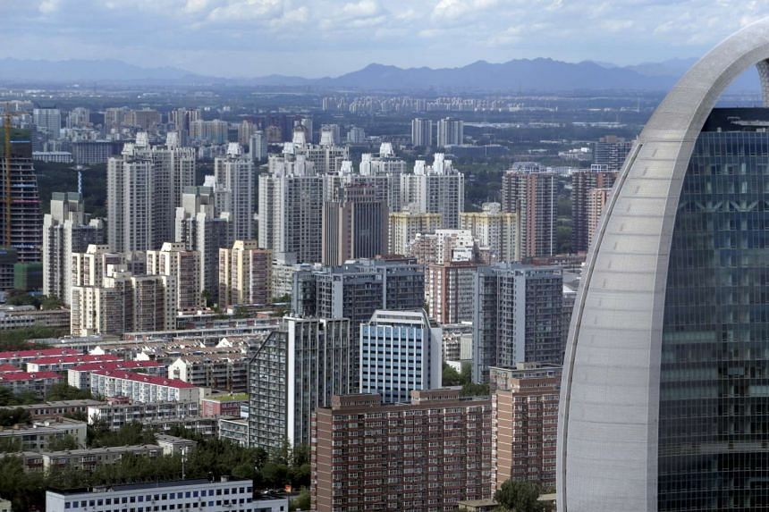Apartment blocks and office buildings are seen in Beijing.