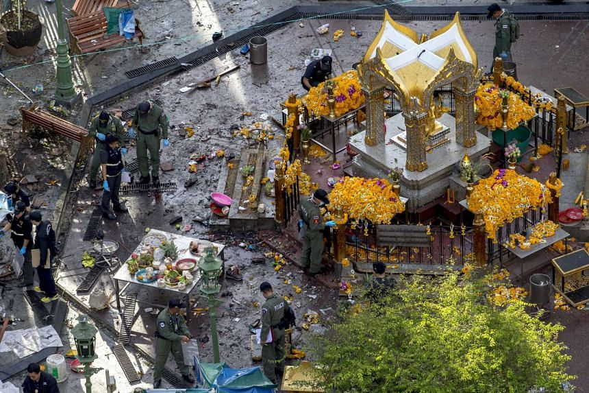 Experts investigate the Erawan shrine at the site of a deadly blast in central Bangkok, Thailand on Aug 18, 2015.