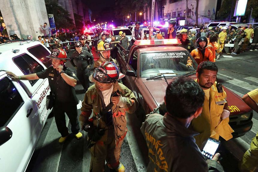 Emergency vehicles and members of the Fire Department arrive to assist following an explosion at the Ratchaprasong intersection in Bangkok, Thailand, on Aug. 17, 2015.