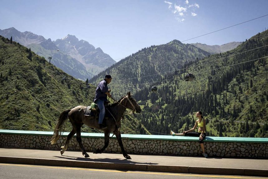 A man rides a horse in Almaty, Kazakhstan last month against the backdrop of the Tien Shan mountains where glaciers have melted at four times the global average.