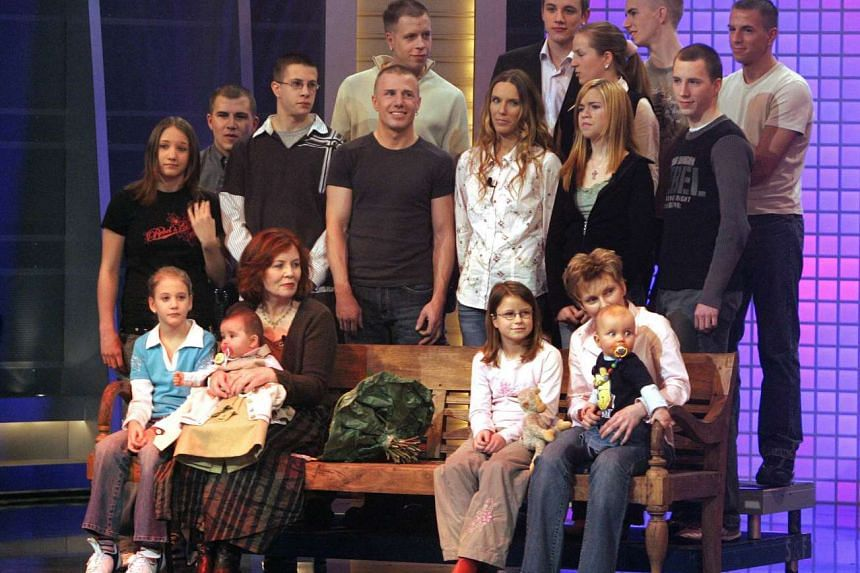 This photo taken on December 11, 2005 shows then 55-old Annegret Raunigk (1st row, 2nd from left), posing with her then youngest daughter Lelia (on her knees) and other children and grand-children in Cologne as guest in a German television show .