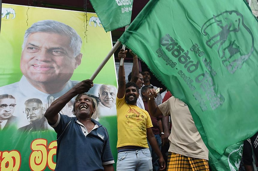 Supporters of Sri Lanka's Prime Minister Ranil Wickremesinghe shout slogans following the Aug 17 general election on Aug 18, 2015.