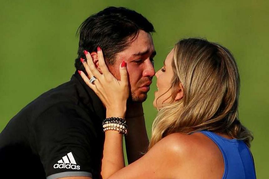An emotional Jason Day celebrating his PGA Championship triumph with his wife Ellie at Whistling Straits. His 20-under 268 total is the lowest score relative to par in a Major. The Australian has climbed to No. 3 in the world rankings.