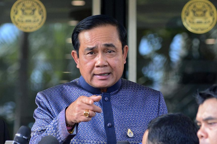 Thai Prime Minister Prayut Chan-o-cha gestures as he speaks to journalists a day after the bomb attack, at Government House in Bangkok, Thailand on Aug 18, 2015.