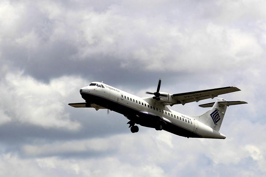 A file picture dated January 10, 2015 shows a plane of the Indonesian domestic airline Trigana taking off at Iskandar Military Airport in Pangkalan Bun, Central Borneo, Indonesia.