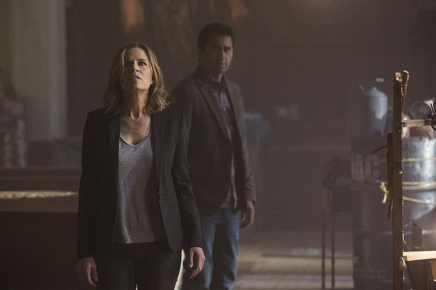 Kim Dickens and Cliff Curtis (both above) in Fear The Walking Dead.
