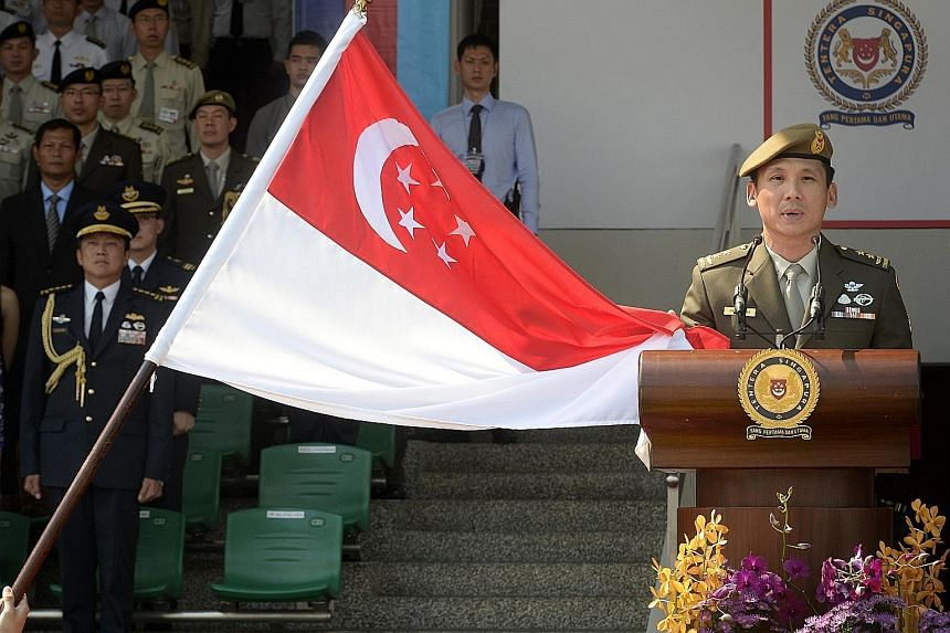 Major-General Perry Lim taking his oath as Singapore's new Chief of Defence Force during the Change of Command Parade at the Safti Military Institute yesterday. He takes over from Lieutenant- General Ng Chee Meng, who is entering politics.
