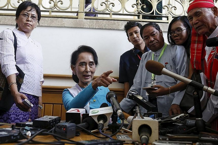 (From top) Mr Shwe Mann, who still holds the post of Speaker of the House in Myanmar's Parliament; Ms Aung San Suu Kyi, whose opposition National League for Democracy will work together with Mr Shwe Mann; and Mr Htay Oo, the newly appointed chairman