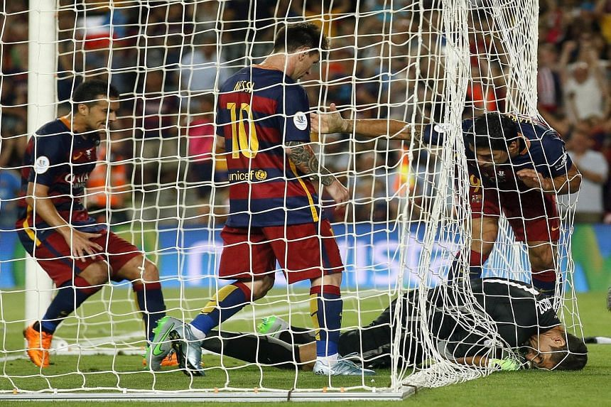 From left: Barcelona attackers Pedro Rodriguez, Lionel Messi and Luis Suarez arguing with Athletic Bilbao goalkeeper Gorka Iraizoz, who tried to hide the ball to run the clock down after Barca pulled a goal back.