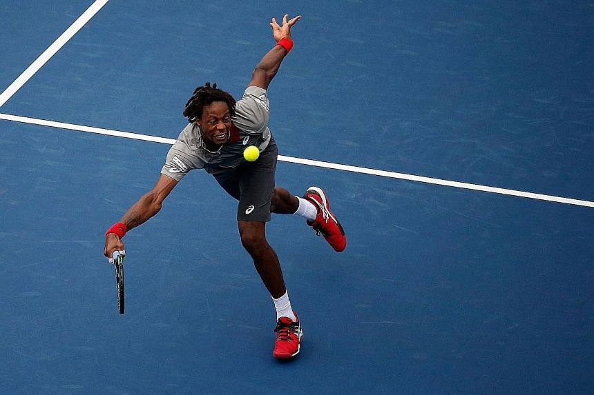 Gael Monfils returning against Jerzy Janowicz in Cincinnati. Television commentators quipped that the Frenchman was in such a hurry that he might have had an appointment to play golf instead.