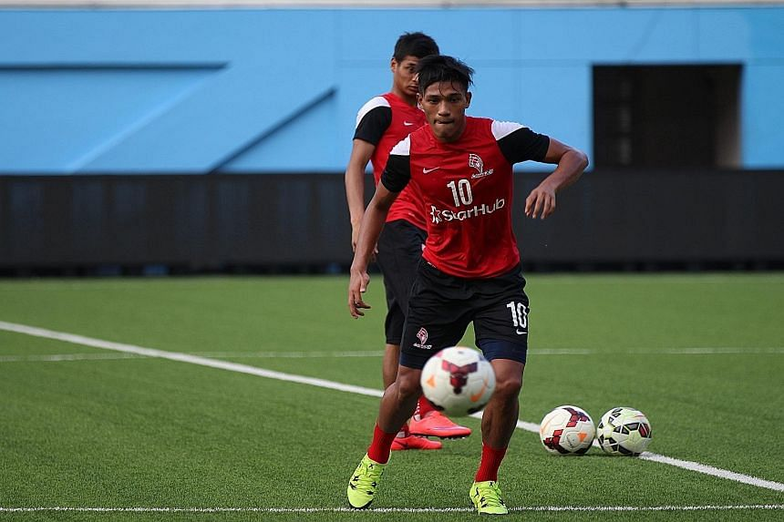 Khairul Nizam in action during LionsXII training at the Jalan Besar Stadium yesterday. The player, whose career has been derailed by a series of long-term injuries, is keen to make up for lost time.
