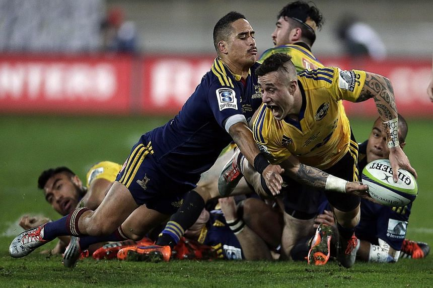 This year's Super Rugby competition was won by New Zealand side Highlanders, who are led by All Blacks star Aaron Smith (blue jersey). They beat the Hurricanes in the July 4 final.