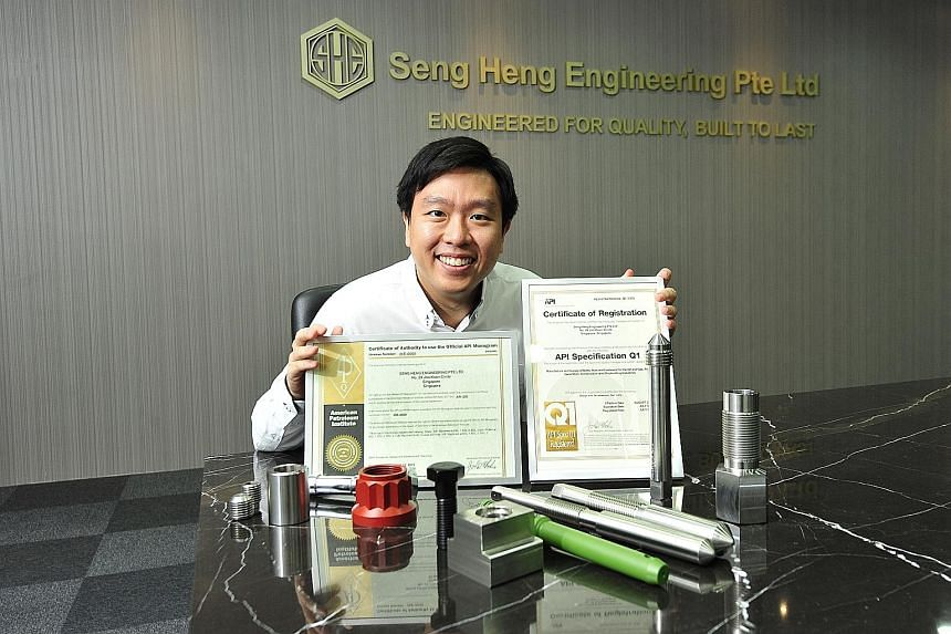 Mr Jackie Lau, managing director of Seng Heng Engineering, with the American Petroleum Institute certificates and samples of fasteners that the company makes.