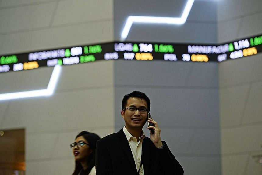 A man using his mobile phone at the Indonesia Stock Exchange in Jakarta on Aug 13.