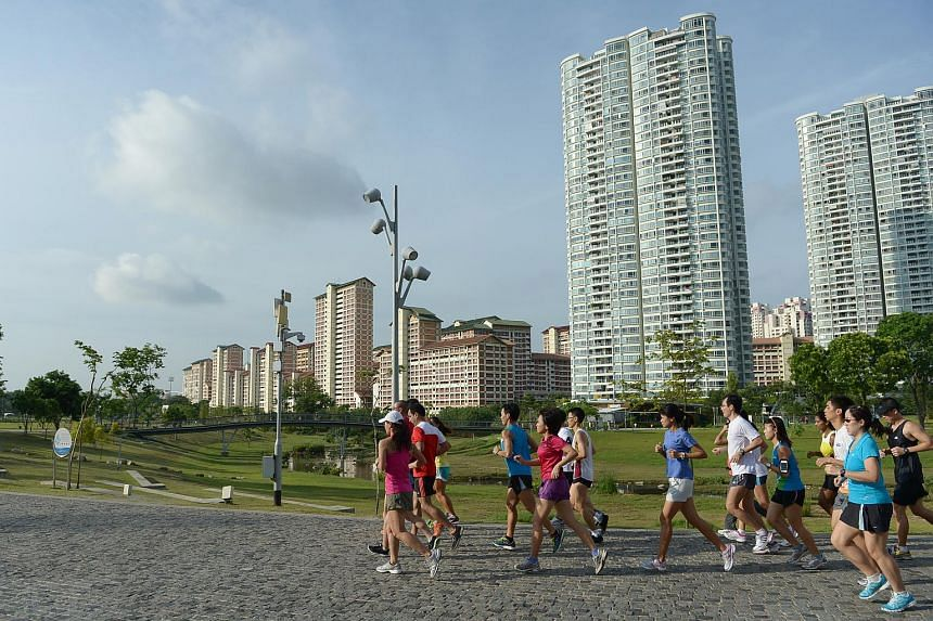 A group of runners making their way around Bishan-Ang Mo Kio Park during the first clinic for the upcoming The Straits Times Run in the Park organised by The Straits Times.