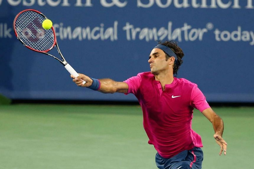 Roger Federer returns a forehand to Roberto Bautista Agut during Day 4 of the Western & Southern Open on Aug 18, 2015.