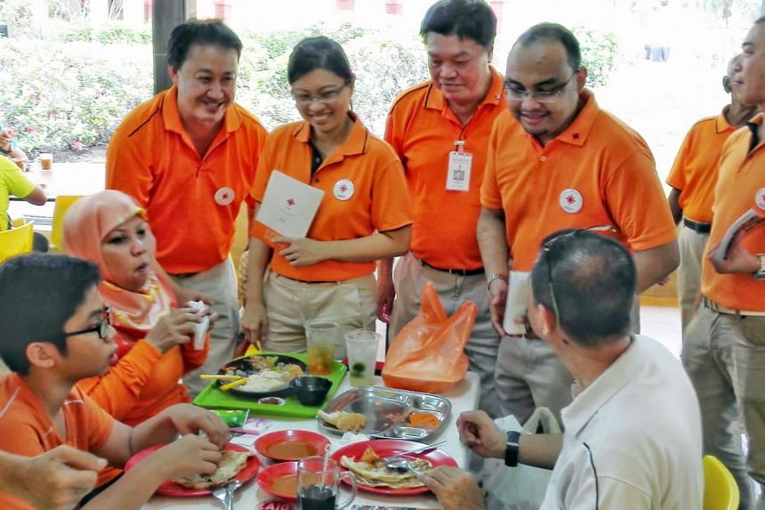 NSP members attending a walkabout in Tampines East on Aug 14, 2015. The NSP is reversing its earlier decision to withdraw from MacPherson SMC.