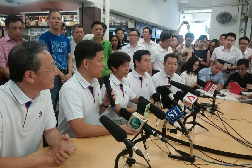 (From left to right) Sam Tan who will be contesting in Radin Mas SMC. The five-member Tanjong Pagar GRC team are Mr Chan Chun Sing, Ms Indranee Rajah, Dr Chia Shi-Lu, Mr Melvin Yong and Ms Joan Pereira (not pictured).