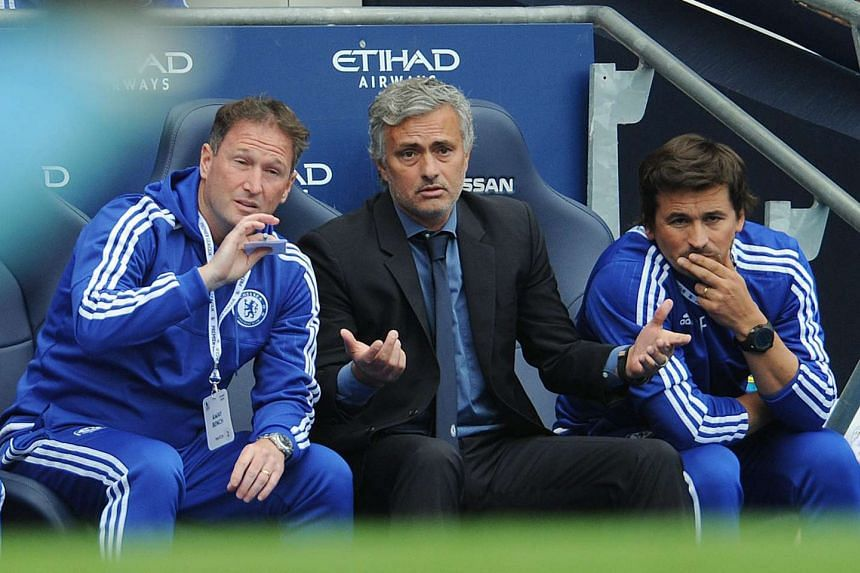 Chelsea manager Jose Mourinho (center) reacts during the English Premier League soccer match between Manchester City and Chelsea at Etihad Stadium, Manchester, Britain on Aug 16, 2015.