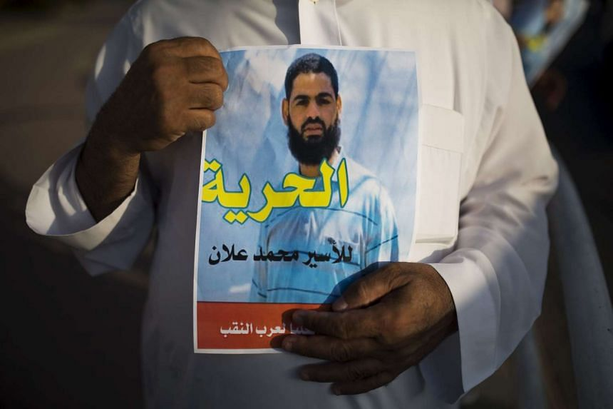 A Bedouin demonstrator holds a sign during a protest in the southern town of Rahat, Israel, in support of Islamic Jihad activist Mohammed Allan, who is in the ninth week of a hunger strike against his detention without trial.