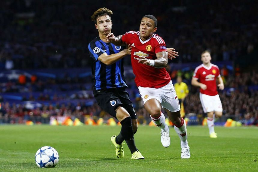 Manchester United's Memphis Depay in action with Club Brugge's Dion Cools.