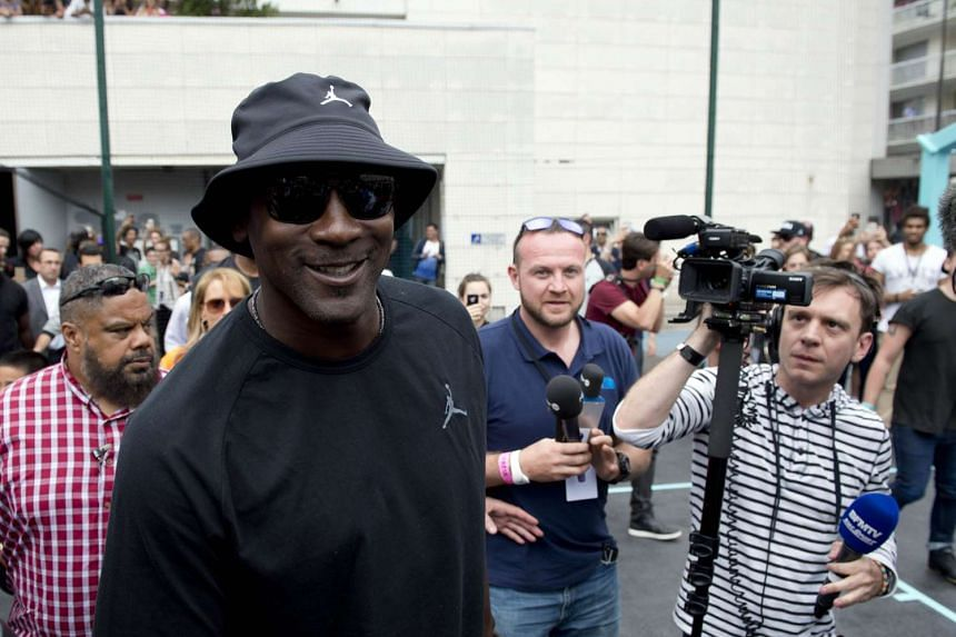 US basketball legend Michael Jordan arrives for the inauguration of a street basketball court in the Haies sports ground in Paris on June 14.