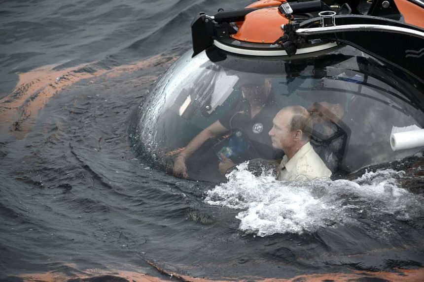Russian President Vladimir Putin (front) is seen inside a research bathyscaphe while submerging into the waters of the Black Sea as he takes part in an expedition near Sevastopol, Crimea on Tuesday.