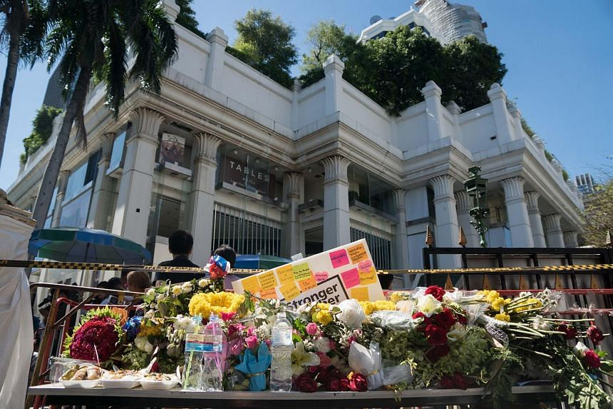 Flowers are laid at the entrance to the reopened Erawan shrine in Bangkok on Aug 19, 2015.