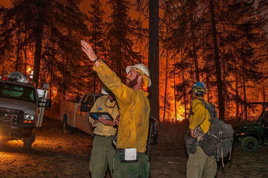 Firefighters preparing to face the Wolverine wildfire near Chelan, Washington state, on Sunday. More than 29,000 civilian fire personnel are battling about 95 major wildfires tearing across seven western states. The fires have already scorched more t