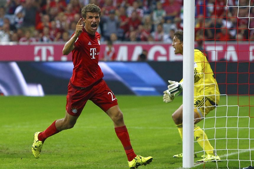 Bayern Munich's Thomas Mueller celebrates after scoring a goal on Aug 14, 2015.