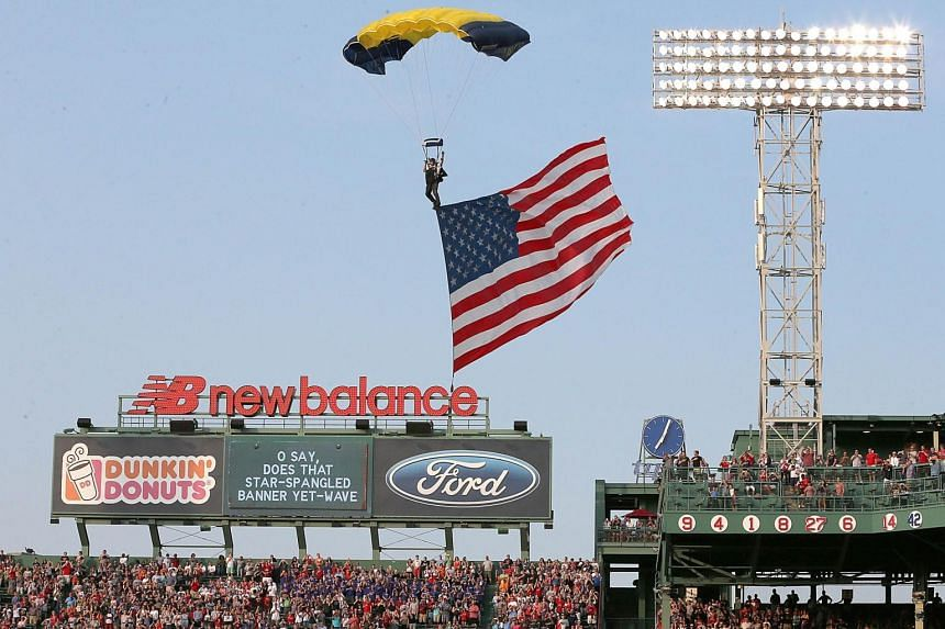 A US Navy Seal landing before a game at the Houston Astros in Boston on July 3.