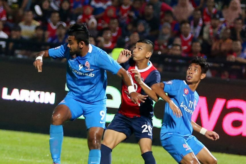 LionsXII right-back Faritz Abdul Hameed (left) and right winger Nazrul Nazari defending against Johor Darul Takzim's Nazrin Nawi during their Malaysia Super League match at the Larkin Stadium on Aug 12, 2015.
