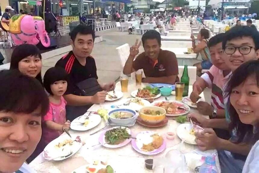 Mr Neoh (third right) with his family and a Thai guide (centre) in a picture taken earlier during their holiday.