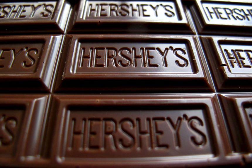 Hershey is hitting a soft spot as the government cracks down on bribery gifts and a meltdown in the stock market has made consumers nervous.