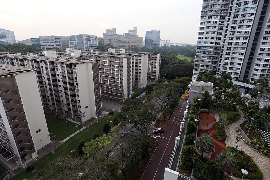 """People working at the nearby Biopolis cut across Commonwealth Drive estate after work to get to the nearby Commonwealth MRT station. The abandoned 10-storey blocks, known in Hokkien as """"chap lau chu"""", on the left stand in sharp contrast to the new fl"""