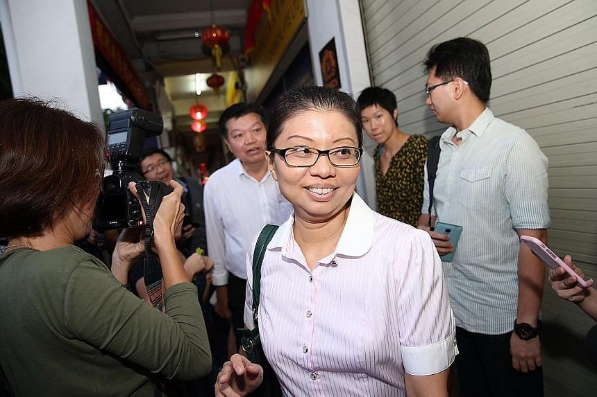 National Solidarity Party acting secretary-general Hazel Poa and president Sebastian Teo arriving at its headquarters on Aug 6 for talks among the opposition parties to avoid multi-cornered fights. Ms Poa has now quit the party and said that she will