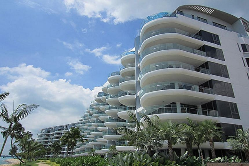 One property that was put up for auction was a 4,133 sq ft duplex penthouse at the Seascape (above) in Sentosa Cove. The apartment was sold for about $5.8 million in May - at a $5.2 million loss.