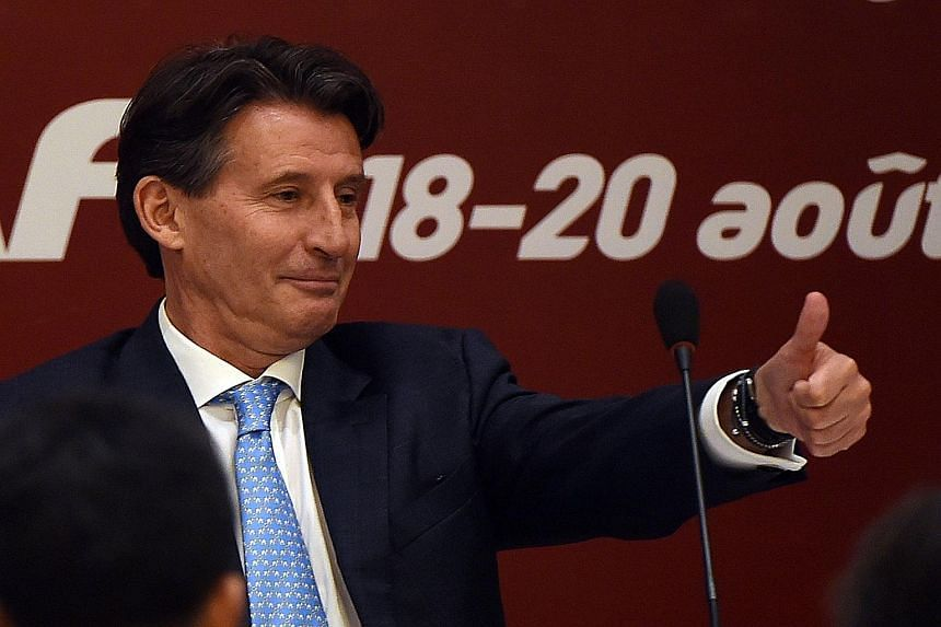 International Association of Athletics Federations (IAAF) president Sebastian Coe gives a thumbs-up after his election victory over Sergey Bubka in Beijing yesterday.