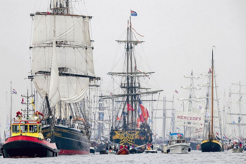 A parade of tall ships, surrounded by smaller, heritage ships, moving from Ijmuiden to Amsterdam in the Netherlands yesterday at the Sail Amsterdam event. The nautical festival first took place in 1975, on the 700th anniversary of the city, and has b