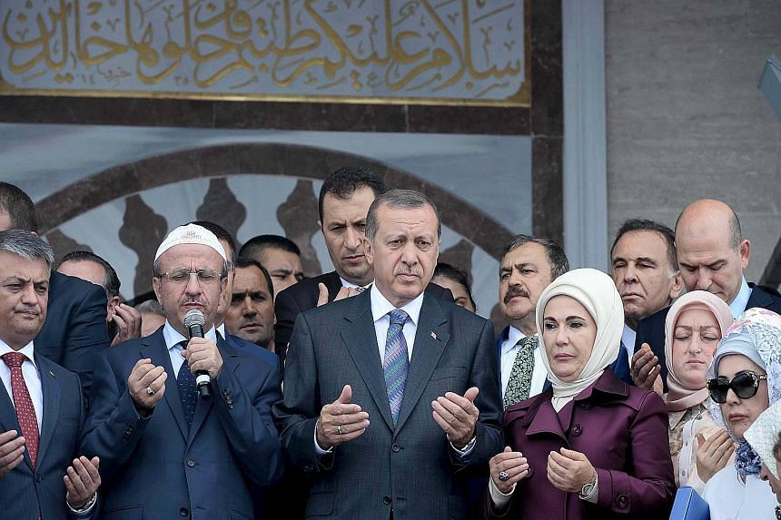 An ISIS video, the first in Turkish language, calls on Muslims in Turkey to revolt against President Tayyip Erdogan (front row, third from left)