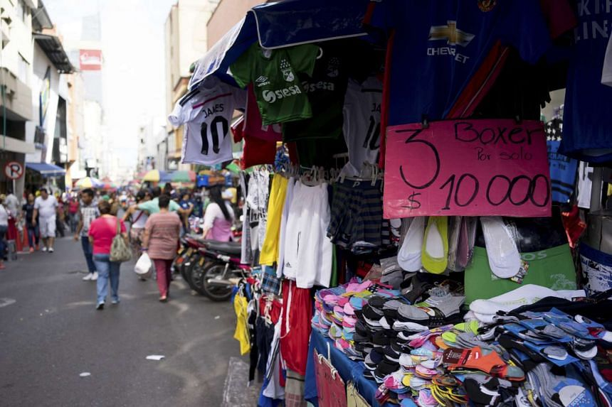 Street vendors in Cali, Colombia, whose real effective exchange-rate has depreciated 24 per cent in the past 12 months.