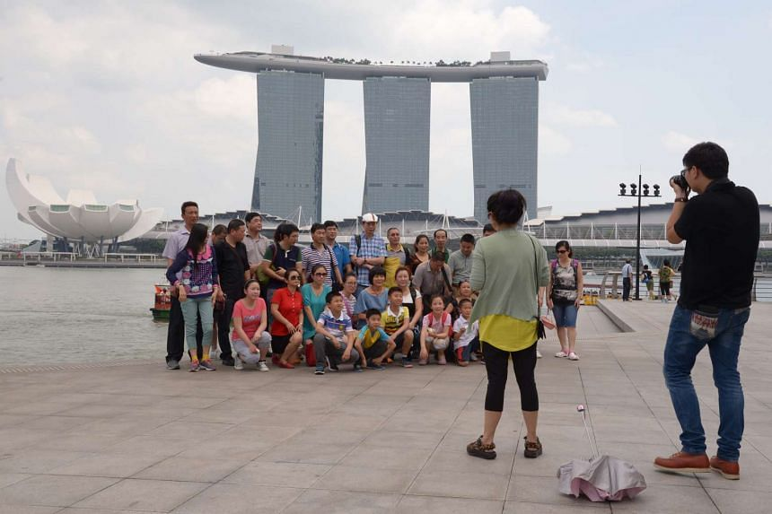 Tourists gathering for a shot in front of Marina Bay Sands.