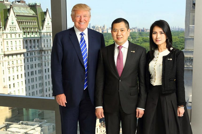 (From left) Mr Donald  Trump with MNC Group CEO Hary Tanoesoedibjo and his wife Liliana at a signing ceremony in New York City on Aug 14, 2015.