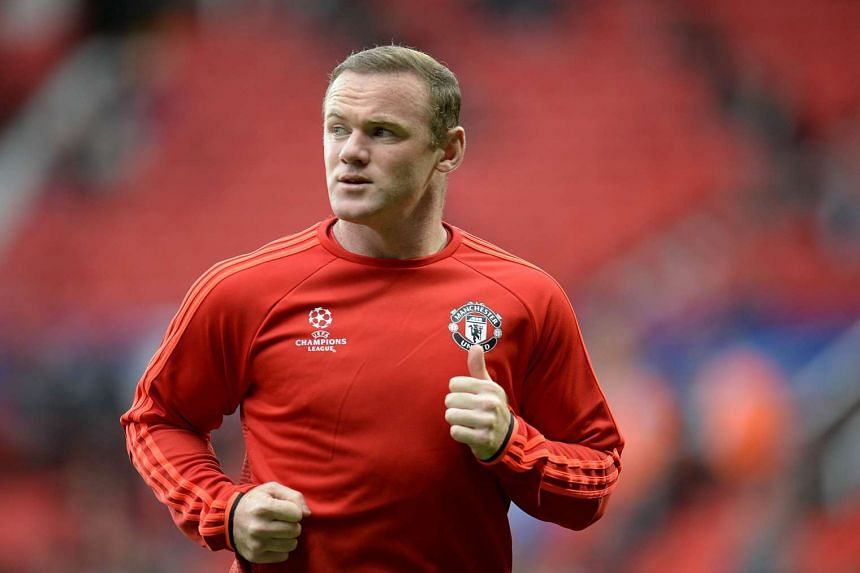 Manchester United's Wayne Rooney warming up before the start of a Uefa Champions League play off football match between Manchester United and Club Brugge at Old Trafford on Aug18, 2015.