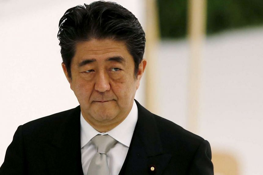 Japan's Prime Minister Shinzo Abe attends a memorial service ceremony marking the 70th anniversary of Japan's surrender in World War Two at Budokan Hall in Tokyo on Aug 15, 2015.