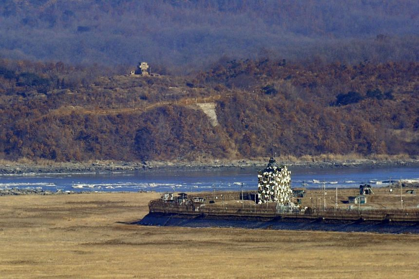 A North Korean guard post (top) and a South Korean guard post (centre right) stand opposite each other near the Demilitarized Zone (DMZ) dividing the two Koreas on Jan 25, 2013.