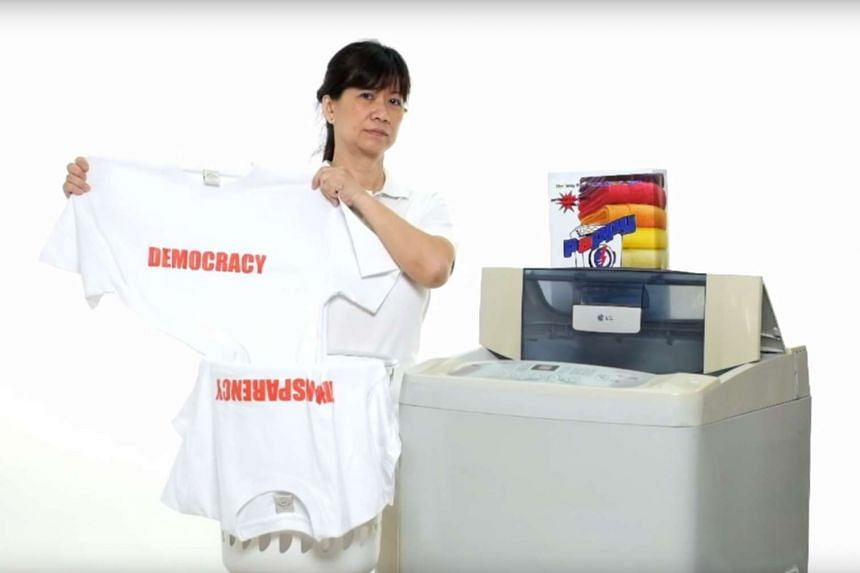 The video shows a woman using washing powder named Pappy White.