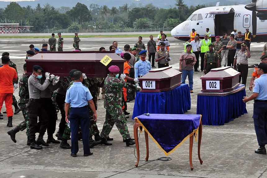 Indonesian rescuers carry a coffin of a victim of the crashed Trigana Air plane as they arrive at Sentani Airport, near Jayapura, Papua, Indonesia on Aug 19, 2015.